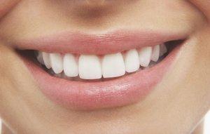 Вставить зубы из металлокерамики